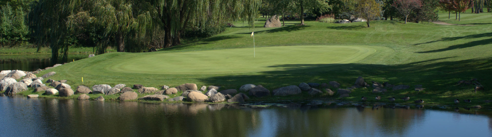 View of a pond on the course at Prairie Isle Golf Course